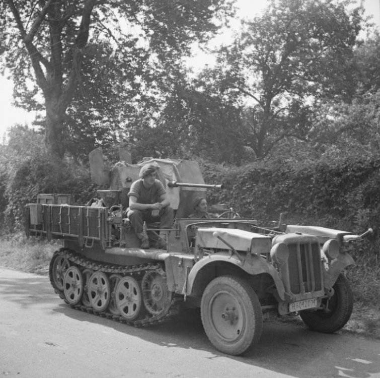 6th_Airborne_Division_with_captured_German_half_track.thumb.jpg.19fcc55f469a64636ce64322969121ec.jpg